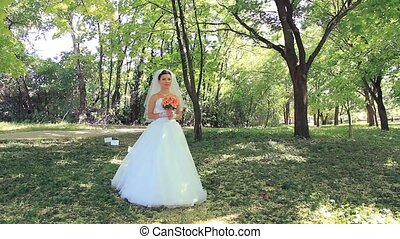 Bride And Groom In A Park - Bride and groom meeting in a...