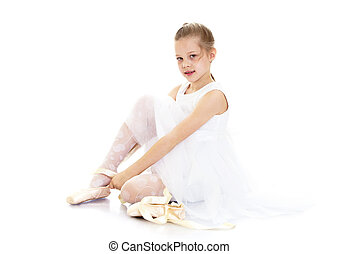 The girl wears Pointe shoes - Beautiful blond little girl...