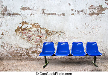 Blue chair on the floor with grunge background