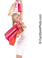 shopper - happy woman with shopping bags over white