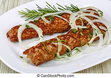 Beef kebab - Hot Beef kebab with onion rings and rosemary