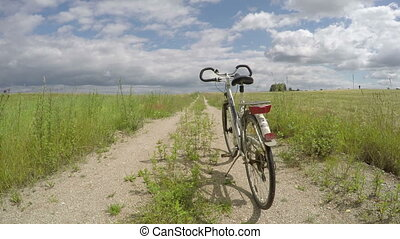 bicycle on rural farmland road - one bicycle on rural...