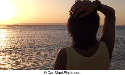 Woman Admire Sinrise over the sea