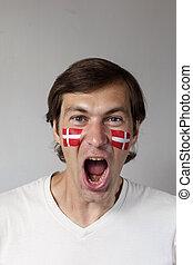 Happy Danish sports fan - Happy male sports fan with face...