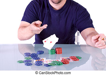 Man Throwing Cards on the Table in Texas Hold\'em