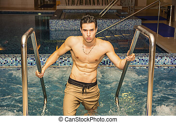 Young Man Relaxing in Spa Whirlpool - Handsome Athletic...