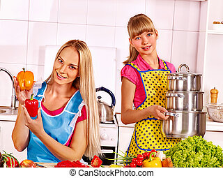 Mother and daughter cooking at kitchen - Mother and daughter...