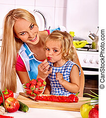 Mother and child cooking at kitchen - Mother and daughter...
