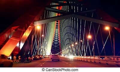 bridge with red arch at night