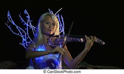 Violinist Plays In The Magical Dress - Beautiful violinist...