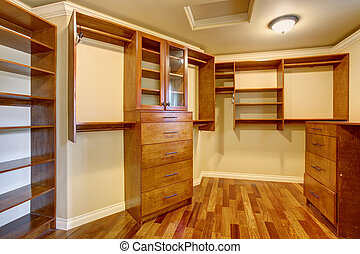 Large walk in closet with many shelves and drawers. - Large...