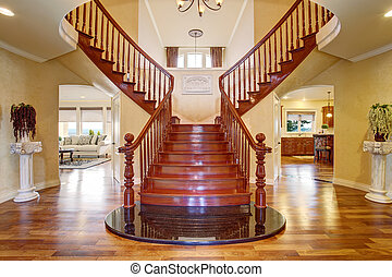 Elegant double staircase with a chandelier. - Elegant luxury...