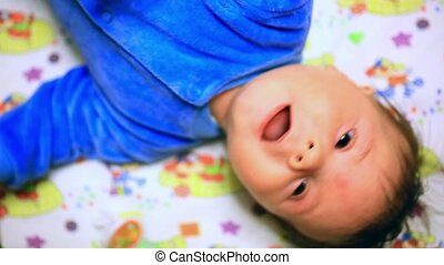 happy baby on diaper and looks around - happy baby lies and...