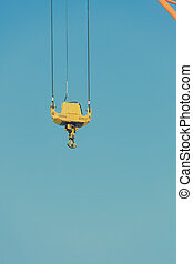 Crane hook at port area and blue sky