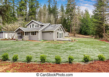 Lovely back yard with porch, and grass. - Lovely back yard...