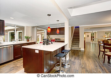 Large kitchen with white counter tops - Large kitchen with...