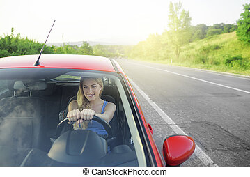 Girl in car. - Girl behind wheel of a car on the highway...