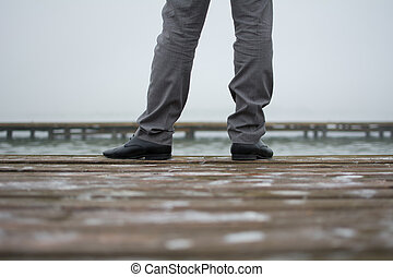 Man in elegant shoes and trousers. Photographed from behind...