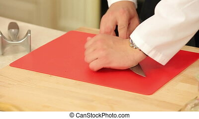 Chef Chopping Garlic on the Cutting Board with a Knife HD