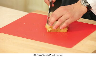 Chef Cutting White Bread into Pieces to Cook Croutons HD