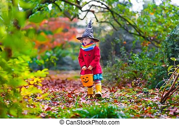 Little girl in witch costume at Halloween - Little girl in...