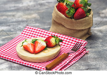 Group of strawberries on wooden plate