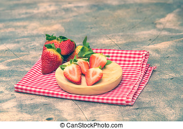 Strawberries on wooden plate in pastel colors