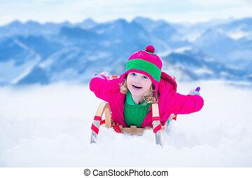Little girl having fun at sleigh ride - Little girl enjoying...