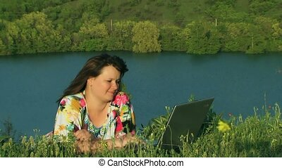 Woman Outdoors With Laptop