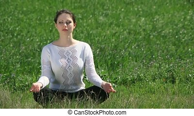 Girl Sits In The Lotus Position - A beautiful girl sitting...