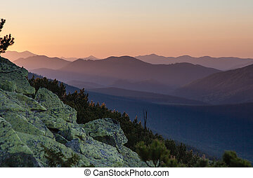 Pretty range of mountains at sunset - Pretty range of...