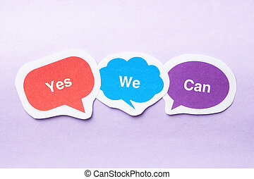 Yes we can concept paper bubbles against purple background.