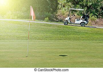 Golf cart next to a hole