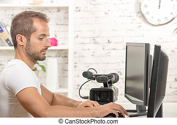 video editor with computer and professionnal video camera