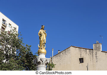 immaculate virgin under blue sky in Marseille