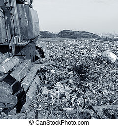 Landfill - Transportation over the daily garbage piled...