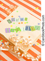 youre invited - cut out letters spelling youre invited on...
