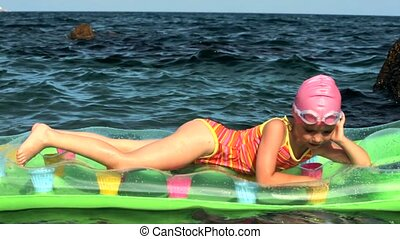 Little Girl On A Mattress In The Sea