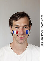 Happy French sports fan - Happy male sports fan with face...
