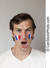 Angry French sports fan - Angry male sports fan with face...