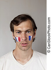 Upset French sports fan - Upset male sports fan with face...