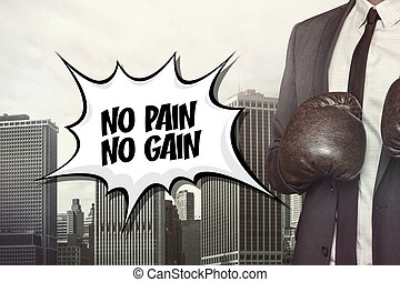 No pain no gain text with businessman wearing boxing gloves...