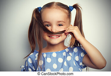 happy face funny child girl in blue