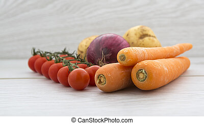 Heathly Vegtables on a light wood background