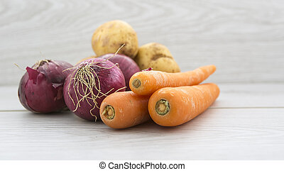 Healthy Vegetables on a light wood background