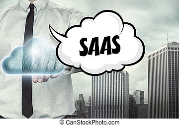 Saas text on cloud computing theme with businessman on...