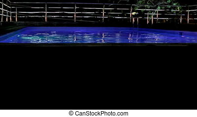 swimming pool at luxury hotel in night illumination -...
