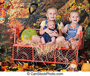 Three Young Siblings in the Fall