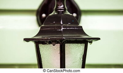 Drops Of Water Flowing Down On Street Lamp - This is a...