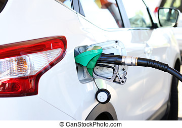 refilling the car with fuel in gas station